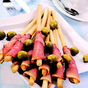 prosciutto with grissini and olives for party